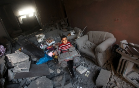 Palestinian_Boy_Toy_Debris_Destroyed_Home_Following_Apartheid_Zionist_Regime_Israeli_Air-Strike_Gaza_City